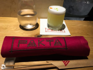 Seats at the bar with a pisco sour to start (Pakta)