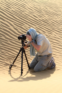 Photographing under difficult conditions in the deserts on the border of India and Pakistan. (Photo courtesy Adam Bannister.)